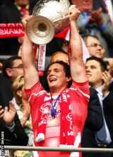 Wigan captain Sean O'Loughlin lifts the 2011 Challenge Cup