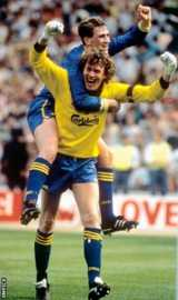 Andy Thorn celebrates Wimbledon's FA win over Liverpool at Wembley with matchwinning penalty hero Dave Beasant