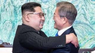 North Korean leader Kim Jong-un (left) and South Korean President Moon Jae-in embrace at the truce village of Panmunjom, South Korea, 27 April 2018