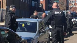NCA officers searching a car in Oldham