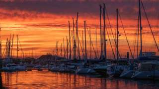 The sun setting over Lymington Yacht Haven in Hampshire