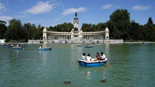 People enjoy boat rides on a lake at Retiro Park on the day that Unesco added Madrid's historic Paseo del Prado boulevard and Retiro Park to its list of world heritage sites, in Madrid, Spain, 25 July 2021