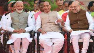 "Narendra Modi (L) looks on as he sits next to Bharatiya Janata Party President Amit Shah (2R) and Minister of Home Affairs of India Rajnath Singh (2L) before Modi""s swearing-in ceremony as Indian Prime Minister at the President house in New Delhi on May 30, 2019"