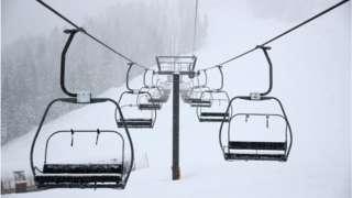 Ski chair lifts at Palisades Tahoe ski resort in California