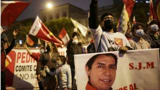 Supporters of Peru's presidential candidate Pedro Castillo gather along a street the day after a run-off election, in Lima, Peru June 7, 2021