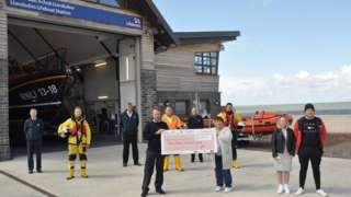 The cheque being handed over