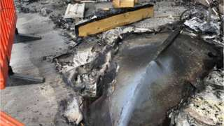 The fire-damaged boat