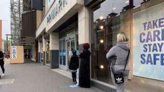 People queuing at shops in Leicester