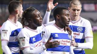 Osman Kakay, Bright Osayi-Samuel and Lyndon Dykes celebrate a goal for QPR