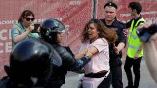 Police detain a protester in Moscow, 27 July