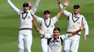 Middlesex paceman Harry Podmore leads his team in an unsuccessful appeal against Warwickshire at Edgbaston