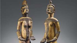 Di wooden objects, one male and one female, represent deities from di Igbo community.
