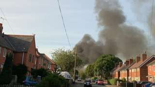 Thick black smoke could be seen rising from the scene of the fire