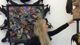 Artist P J Crook surrounded by some of her paintings and sculpture