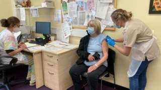 Gwerfyl Gregory receives her first dose of Pfizer vaccine at Ty Doctor in Nefyn