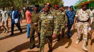 Sudan military council member General Jamal Omar, centre