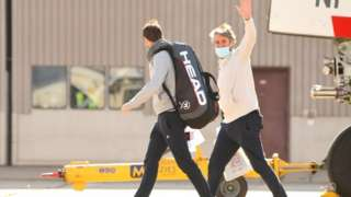 Tennis players and officials exit off QR7176 flight from Doha at Melbourne Jet Base in Melbourne, Australia