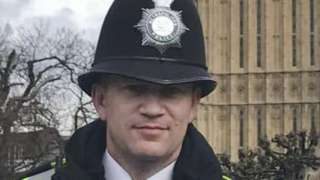 PC Keith Palmer standing outside the Houses of Parliament