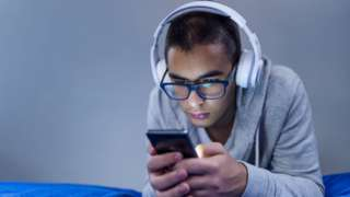 Young man with headphones on