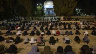 Palestinian Muslims attend prayers for the first time in more than two months at Al-Aqsa Mosque