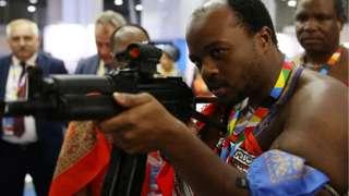 Top goment official from eSwatini carri new Kalashnikov rifle to test