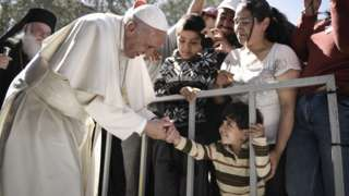 In this handout image provided by Greek Prime Minister's Office, Pope Francis meets migrants at the Moria detention centre on April 16, 2016 in Mytilene, Lesbos, Greece.