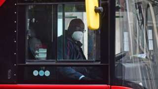 Bus driver with face mask