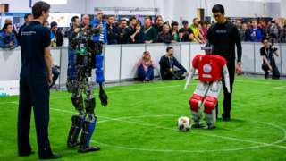 Robots being prepared for a RoboCup Humanoid League game
