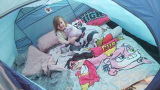 Emma Kyson , five, camping in Swindon, Wiltshire