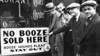 A sign reading n booze sold here in New York, 1929