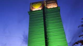 File photo dated October 2019 of the Grenfell Tower illuminated with green lighting
