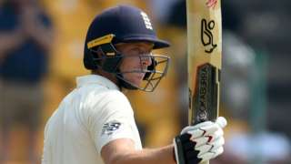 England batsman Jos Buttler raises his bat to acknowledge the crowd after reaching fifty against Sri Lanka