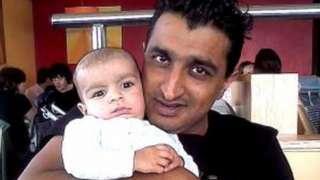 Sajiid Saddique with a child