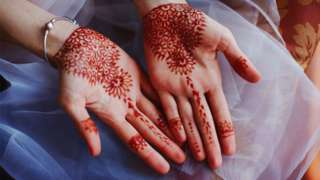 Henna patterns on the hands of a bride
