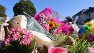 Flowers and tributes by roadside