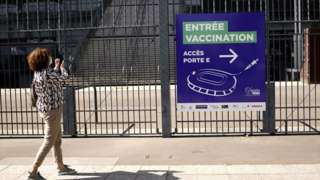Signs of the entrance of a Covid-19 vaccination centre are installed outside France's national stadium, Stade de France, near Paris, France, on 31 March 2021