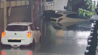 Cars stranded in the road due to flooding
