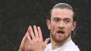 Jack Marriott applauds the Peterborough United fans