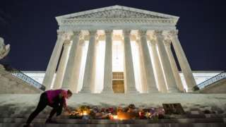 Mourners lay flowers outside the Supreme Court after Ginsburg's death