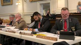 Republican representatives in New Hampshire wearing pearl necklaces