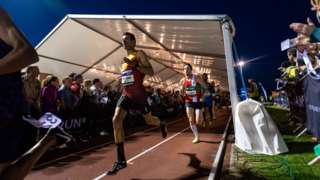 Night of the 10,000m PB's competitors run through a beer tent