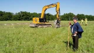 Man dressed as Viking at excavation site
