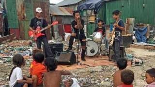 The band play a show for residents of the Phnom Penh neighbourhood they were born