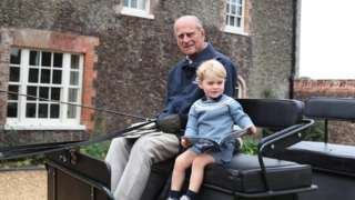 Kensington Palace shared a photograph of Prince George with his great-grandfather Philip, taken by the Duchess of Cambridge
