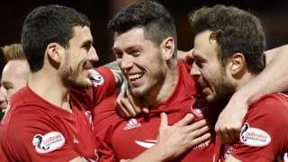 Aberdeen celebrate the goal from Scott McKenna (centre)