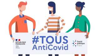 "Three cartoon people hold a banner reading ""tousAntiCvoid"", the name of the new French app, which means ""everyone against Covid"""
