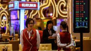 Members of staff prepare for the opening of the casino at the MGM Cotai resort in Macau.