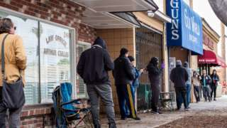 Customers queue outside a LA county gun shop