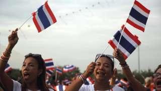 Women wave the Thai flag