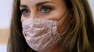 The Duchess of Cambridge wearing a floral face covering